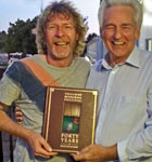 "Sam Bush & Del McCoury with our book ""Forty Years of Festivation"""
